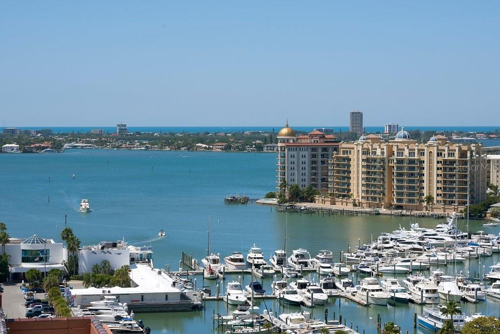Enjoy fitness training while looking to the outdoors and the pool area. - Condo for sale at 1350 Main St #1406, Sarasota, FL 34236 - MLS Number is A4418200
