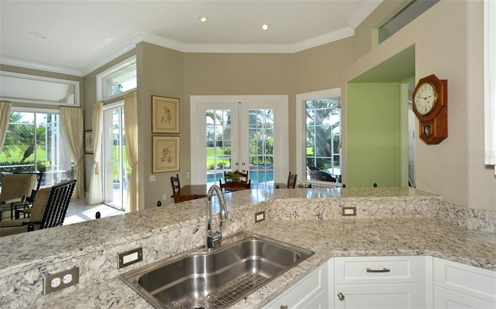 Kitchen to breakfast nook - Single Family Home for sale at 462 Sherbrooke Ct, Venice, FL 34293 - MLS Number is A4418225