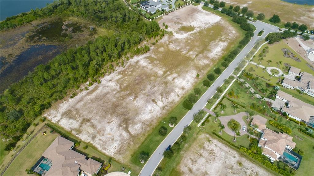 Lot is adjacent to Home on Left side of photo - Vacant Land for sale at 8418 Broadstone Ct, Bradenton, FL 34202 - MLS Number is A4418532