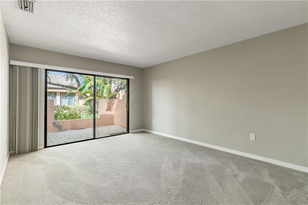 Master Bedroom with private outdoor space. Iron work on outside wall to be replaced by association. - Villa for sale at 5235 Myrtle Wood #18, Sarasota, FL 34235 - MLS Number is A4418558