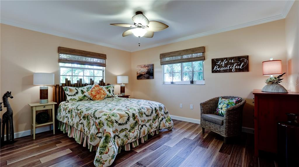 en-suite bedroom - Single Family Home for sale at 612 Ambassador Ln, Holmes Beach, FL 34217 - MLS Number is A4418766