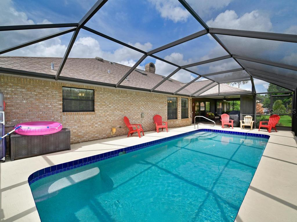 Sparkling blue and HEATED make this so inviting year round! - Single Family Home for sale at 9902 Braden Run, Bradenton, FL 34202 - MLS Number is A4419792