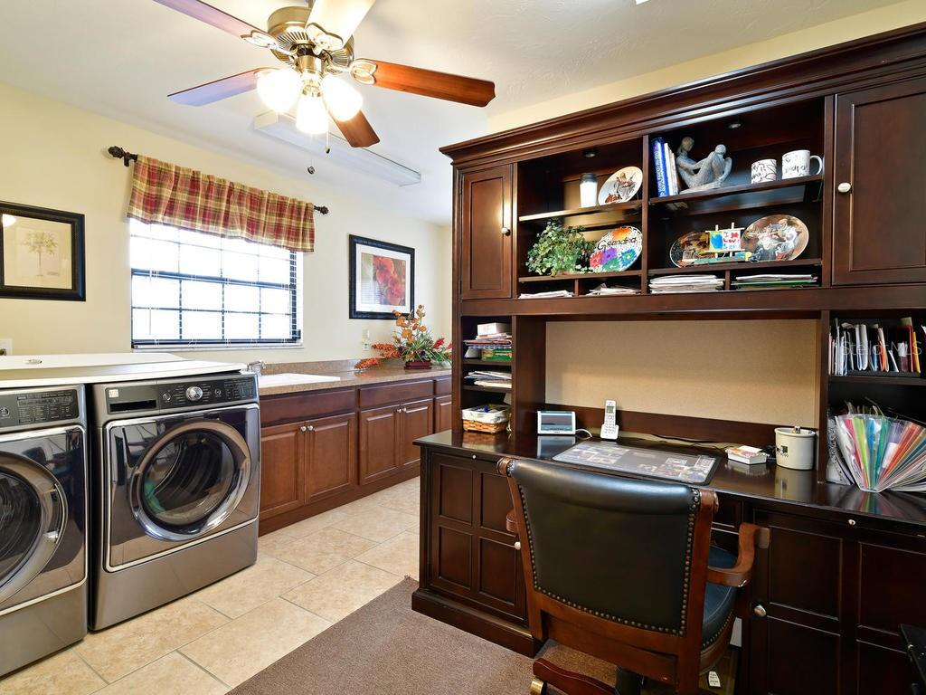 laundry/mud room can fit an office or be an extra bonus space. - Single Family Home for sale at 9902 Braden Run, Bradenton, FL 34202 - MLS Number is A4419792