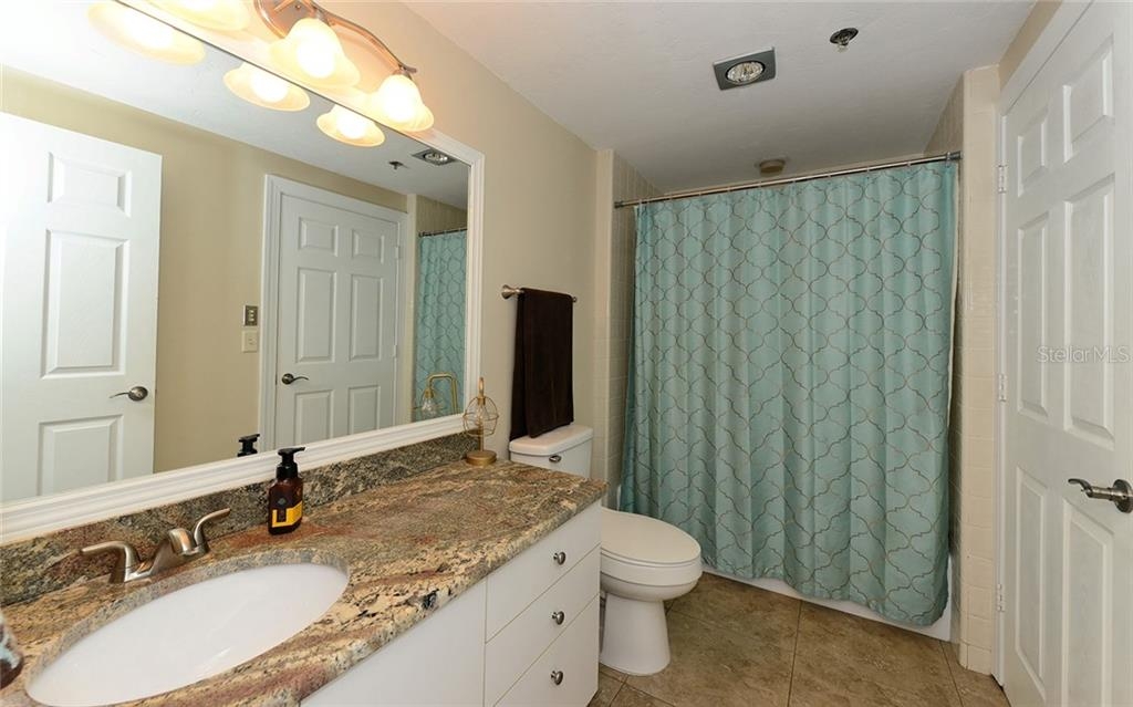 Guest bathroom with shower / tub - Condo for sale at 1930 Harbourside Dr #117, Longboat Key, FL 34228 - MLS Number is A4420232