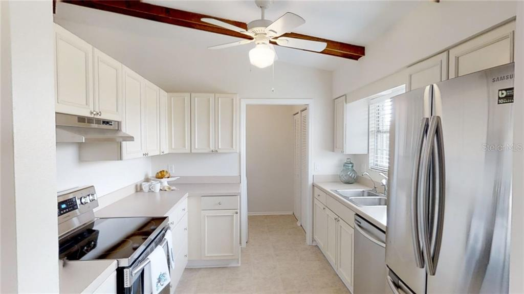 Kraftmade solid wood, soft-close cabinetry and brand new stainless appliances - Single Family Home for sale at 521 75th St, Holmes Beach, FL 34217 - MLS Number is A4420243