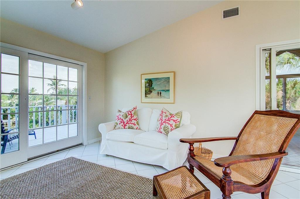 The bonus room offers flexible space to suit your needs - Single Family Home for sale at 521 75th St, Holmes Beach, FL 34217 - MLS Number is A4420243