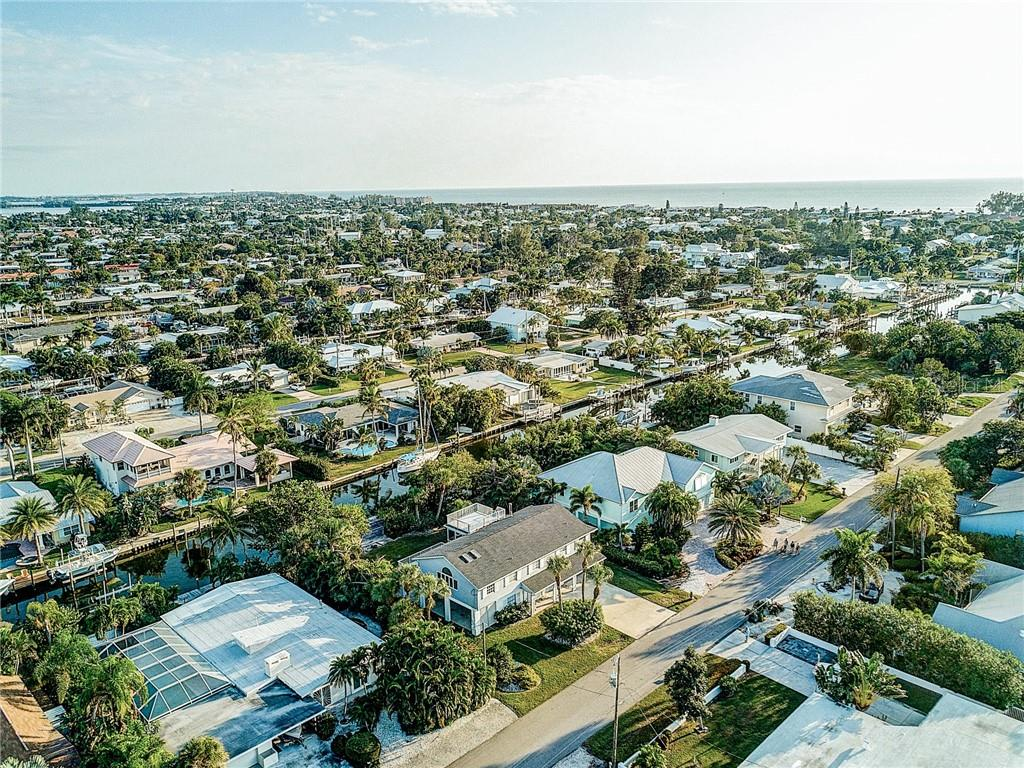 The beautiful azure Gulf waters and sandy beaches are a short few blocks away - Single Family Home for sale at 521 75th St, Holmes Beach, FL 34217 - MLS Number is A4420243
