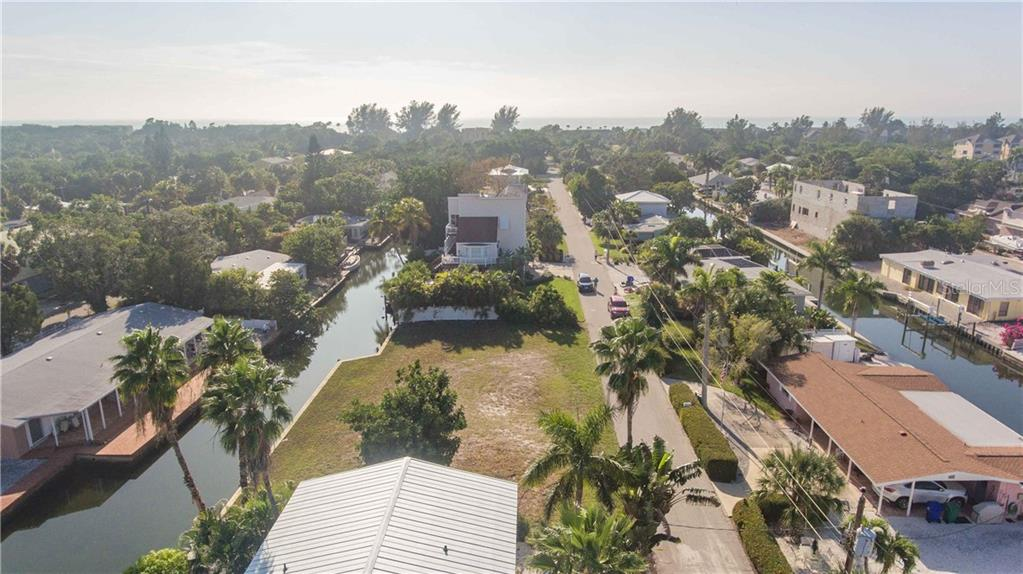 The view west towards the beach - Vacant Land for sale at 700 Tarawitt Dr, Longboat Key, FL 34228 - MLS Number is A4420879