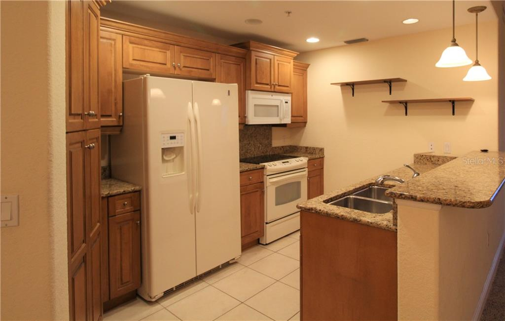 Kitchen - Condo for sale at 501 Haben Blvd #504, Palmetto, FL 34221 - MLS Number is A4421758