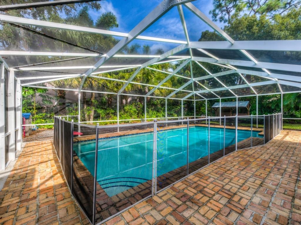 The extra deep salt water pool is the centerpiece of the rear entertaining area and measures a generous 17 x 35! - Single Family Home for sale at 1509 Flower Dr, Sarasota, FL 34239 - MLS Number is A4421898