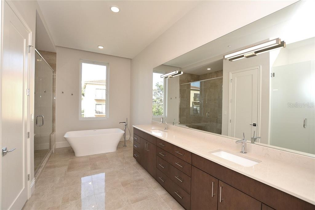 Luxurious master ensuite bath with shower, soaking tub, water closet, spacious linen closet and double vanities. - Condo for sale at 609 Golden Gate Pt #301, Sarasota, FL 34236 - MLS Number is A4422419