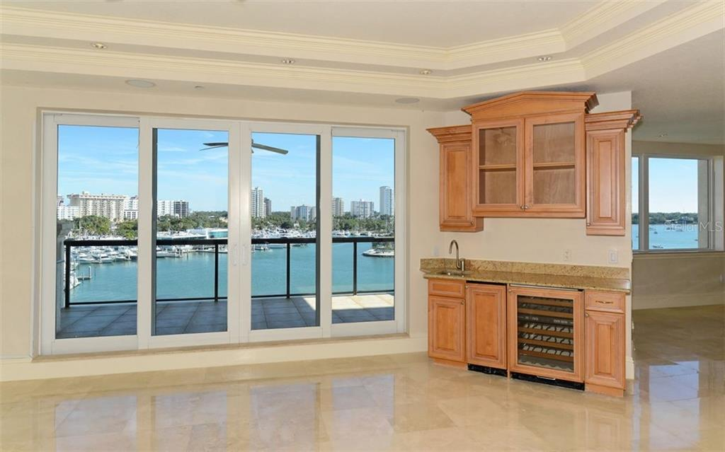 Living Room wet bar area. - Condo for sale at 464 Golden Gate Pt #701, Sarasota, FL 34236 - MLS Number is A4422622