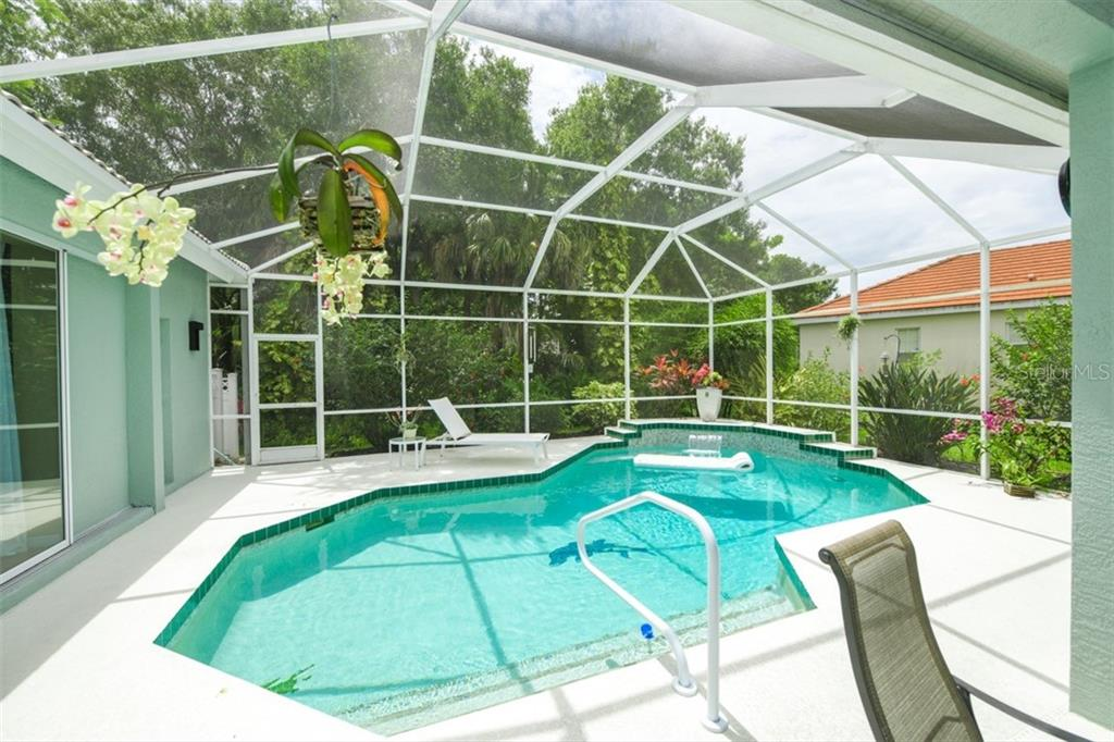 Pool looking toward large back lot with nice foliage for privacy - Single Family Home for sale at 6161 Varedo Ct, Sarasota, FL 34243 - MLS Number is A4422883