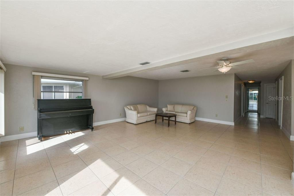 Living room area. - Villa for sale at 3434 Medford Ln #1110, Sarasota, FL 34239 - MLS Number is A4422897