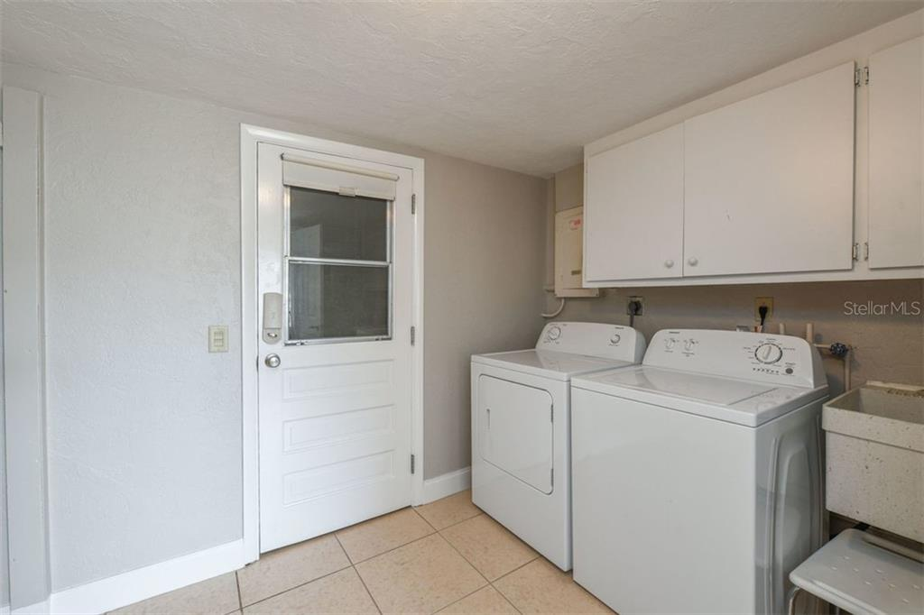 Laundry area between kitchen and garage. - Villa for sale at 3434 Medford Ln #1110, Sarasota, FL 34239 - MLS Number is A4422897