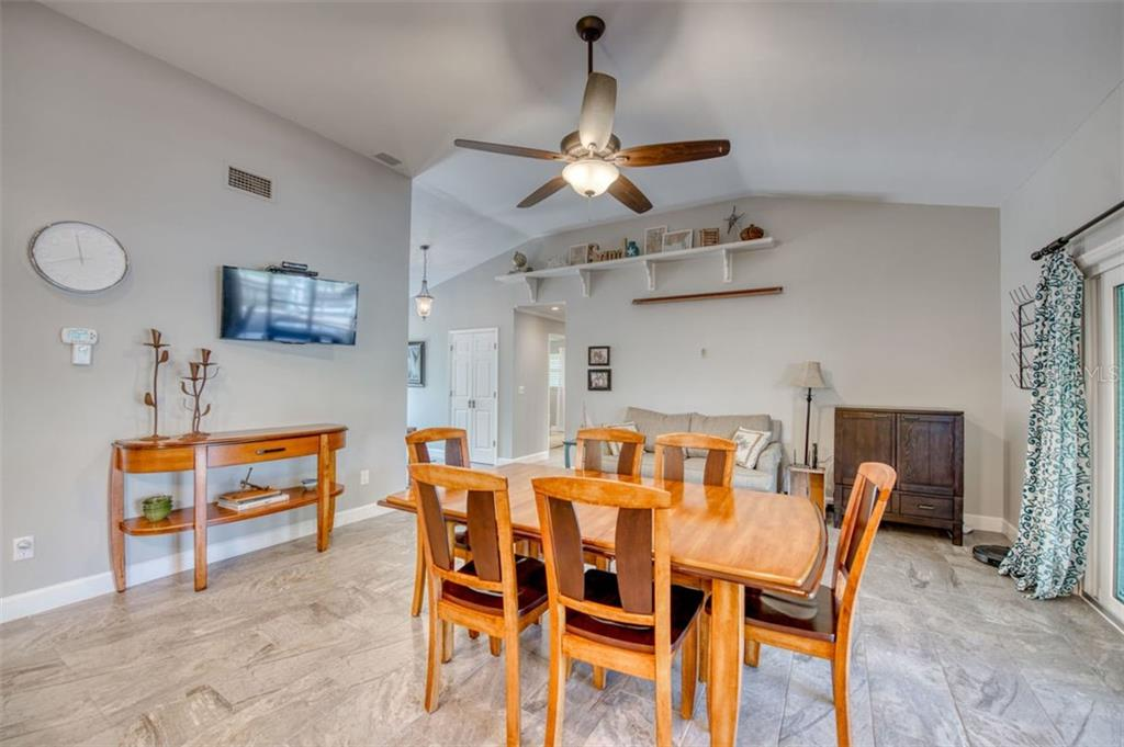 Dining area - Single Family Home for sale at 5548 Shadow Lawn Dr, Sarasota, FL 34242 - MLS Number is A4423461
