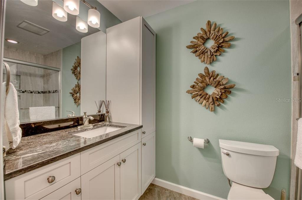 Bathroom for 4th bedroom and guest. - Single Family Home for sale at 5548 Shadow Lawn Dr, Sarasota, FL 34242 - MLS Number is A4423461
