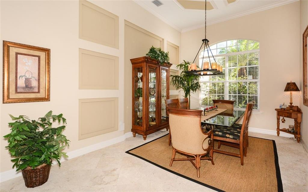 Decorative custom millwork on wall and ceiling - Single Family Home for sale at 2522 Tom Morris Dr, Sarasota, FL 34240 - MLS Number is A4423908