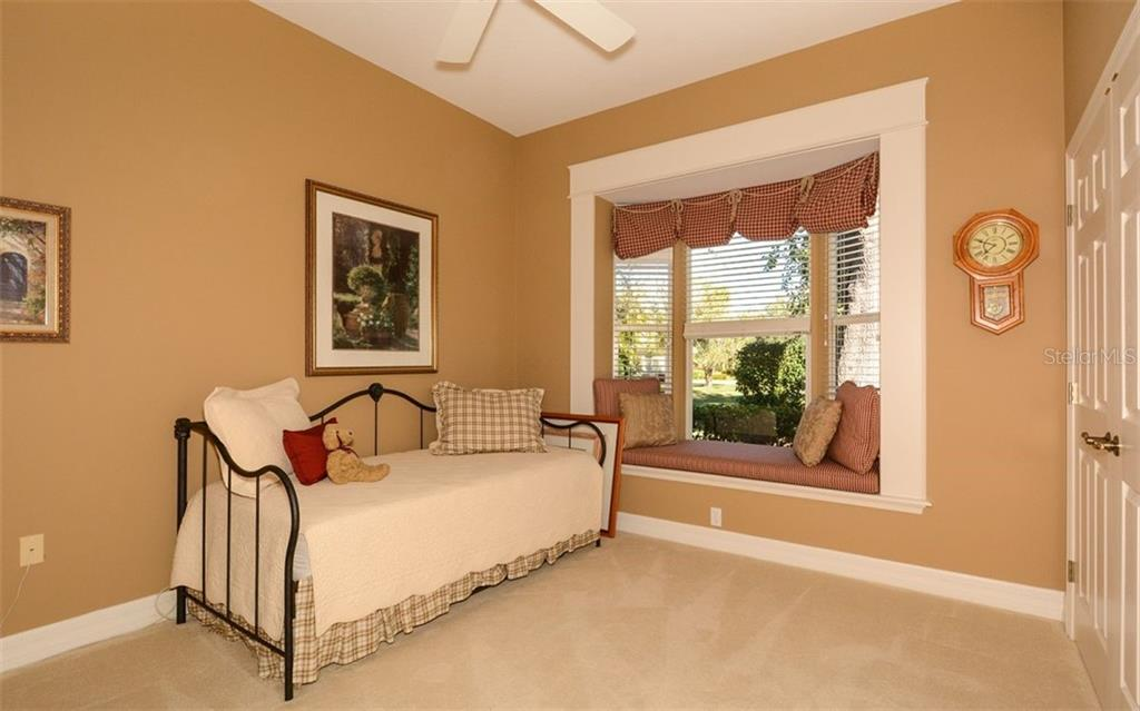Guest Bedroom two with window seat - Single Family Home for sale at 2522 Tom Morris Dr, Sarasota, FL 34240 - MLS Number is A4423908