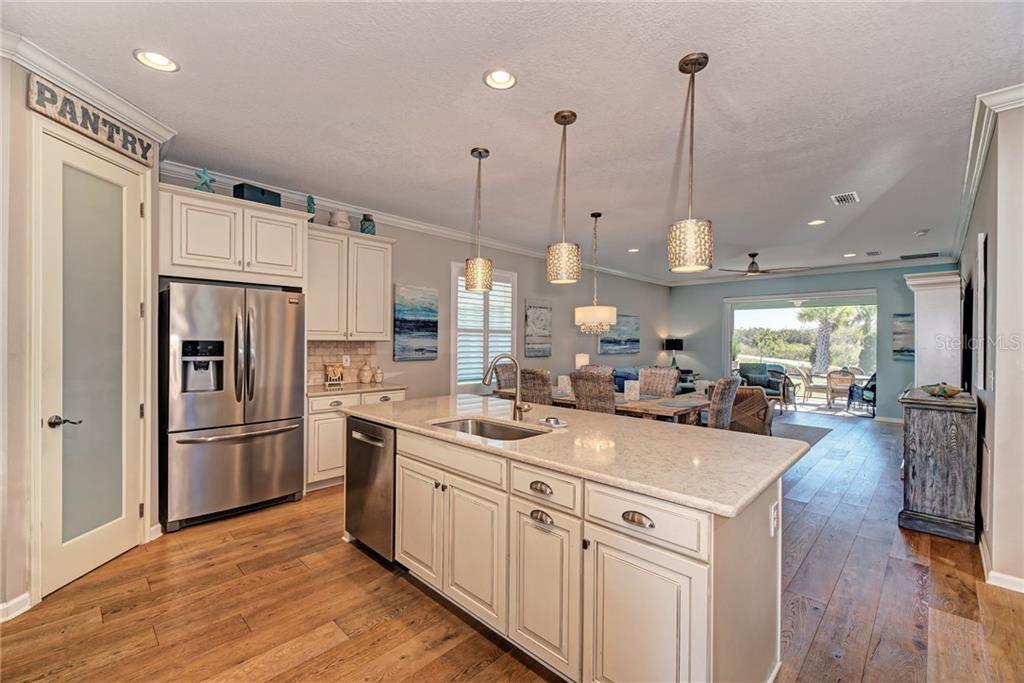 The Kitchen is open to the dining room, living room, and patio with the gorgeous pond and preserve views! - Single Family Home for sale at 5260 Bentgrass Way, Bradenton, FL 34211 - MLS Number is A4424484