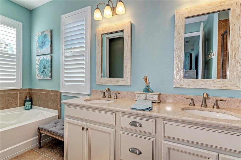 Relax in your Master Bathroom, complete with double sinks, quartz counters, soaker tub, and custom mirrors! - Single Family Home for sale at 5260 Bentgrass Way, Bradenton, FL 34211 - MLS Number is A4424484