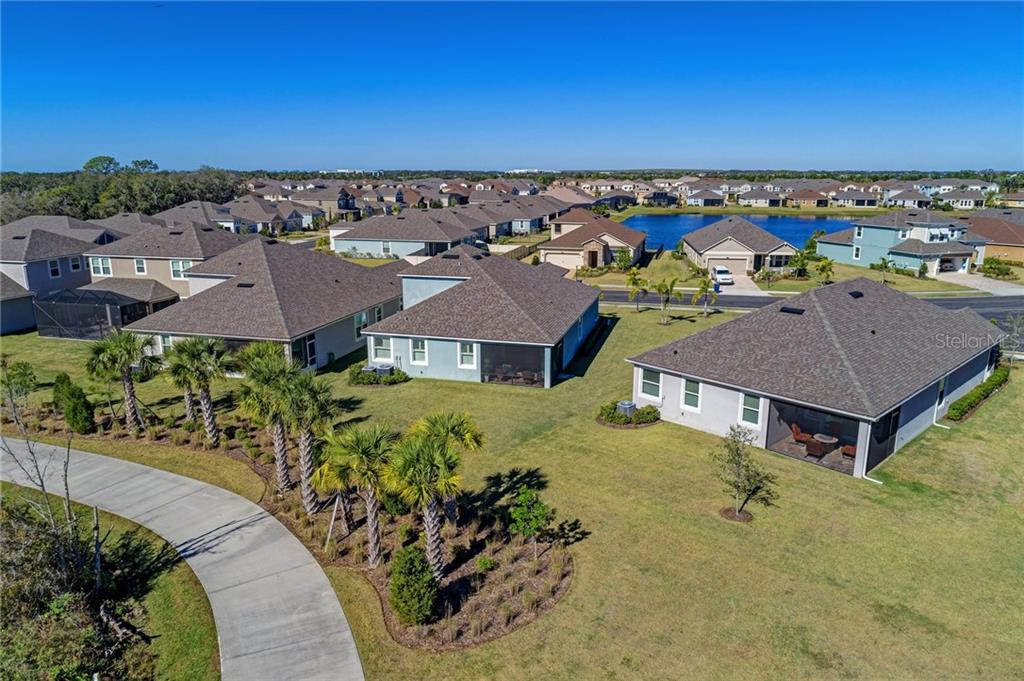 The nature trail behind the house is perfect for taking a walk or riding your bike! - Single Family Home for sale at 5260 Bentgrass Way, Bradenton, FL 34211 - MLS Number is A4424484