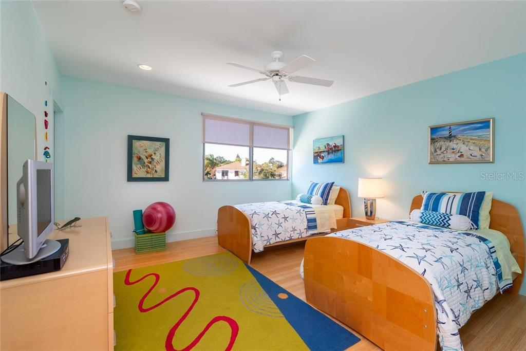 One of two Guest suites with walk-in closets, recessed lighting, bamboo flooring, and hurricane-grade window overlooking the waterway! - Single Family Home for sale at 509 Venice Ln, Sarasota, FL 34242 - MLS Number is A4425092