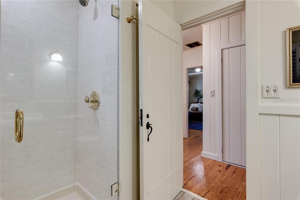 Tiled shower in main house - Single Family Home for sale at 422 Garfield Dr, Sarasota, FL 34236 - MLS Number is A4425287