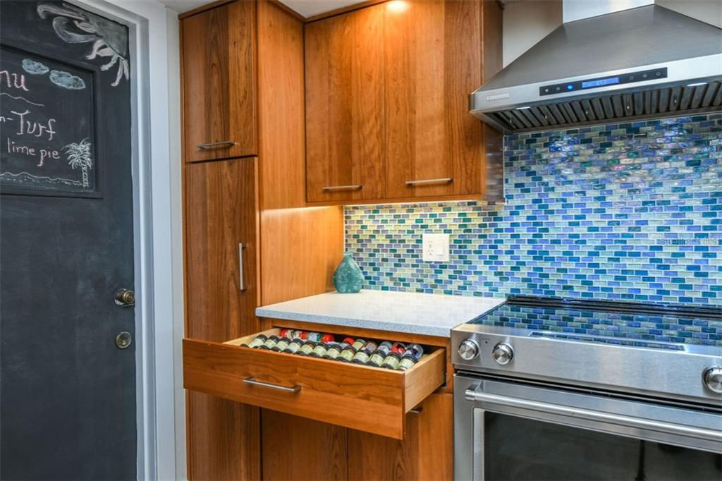 Soft close drawers, and pullout drawers in the cabinets. - Condo for sale at 225 Hourglass Way #208, Sarasota, FL 34242 - MLS Number is A4425323