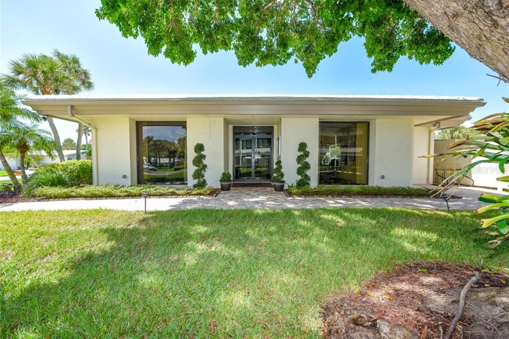 Your unit is just a few steps from the clubhouse with two fitness rooms, catering kitchen, lending library and 2nd heated pool. - Condo for sale at 225 Hourglass Way #208, Sarasota, FL 34242 - MLS Number is A4425323