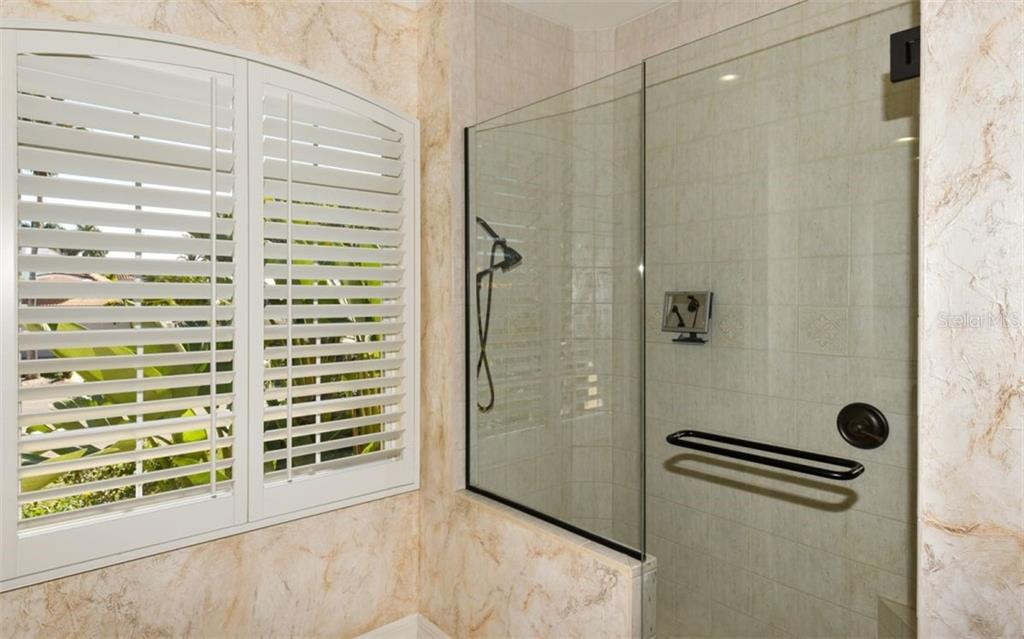 Large Shower, Painted walls  and Plantation shutters - Single Family Home for sale at 561 Ketch Ln, Longboat Key, FL 34228 - MLS Number is A4426280