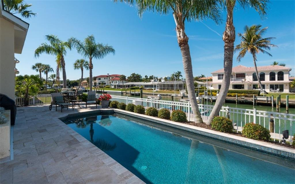 Recently Pebble-Teched Lap Pool,new pool equipment and Travertine deck, patio and lanai - Single Family Home for sale at 561 Ketch Ln, Longboat Key, FL 34228 - MLS Number is A4426280