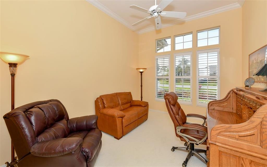 Separate Den off the living room - Single Family Home for sale at 7867 Estancia Way, Sarasota, FL 34238 - MLS Number is A4426528