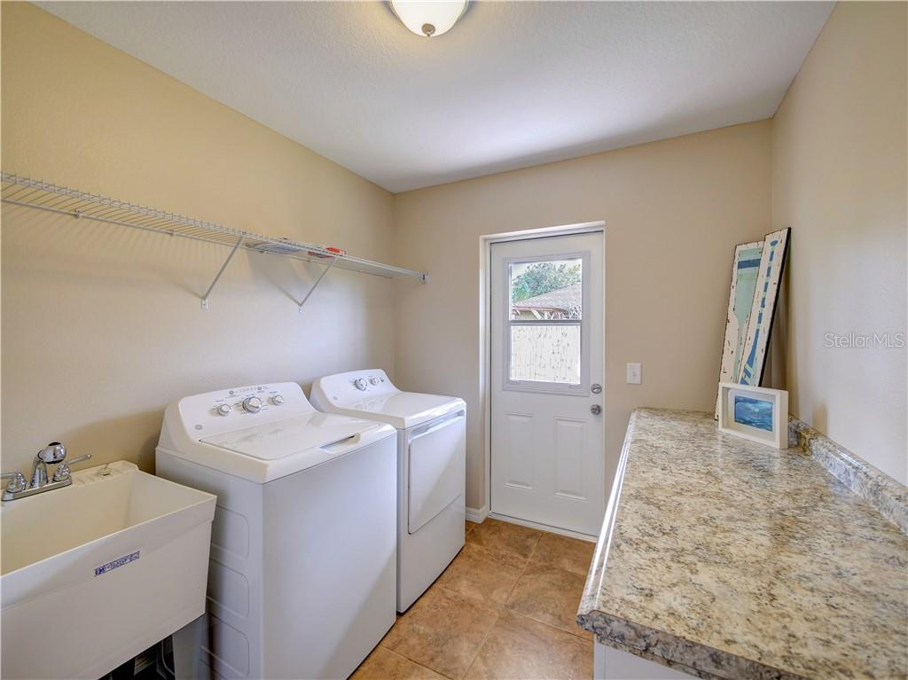 Oversized laundry with extra storage and folding space. - Single Family Home for sale at 2558 Oneida Rd, Venice, FL 34293 - MLS Number is A4428145
