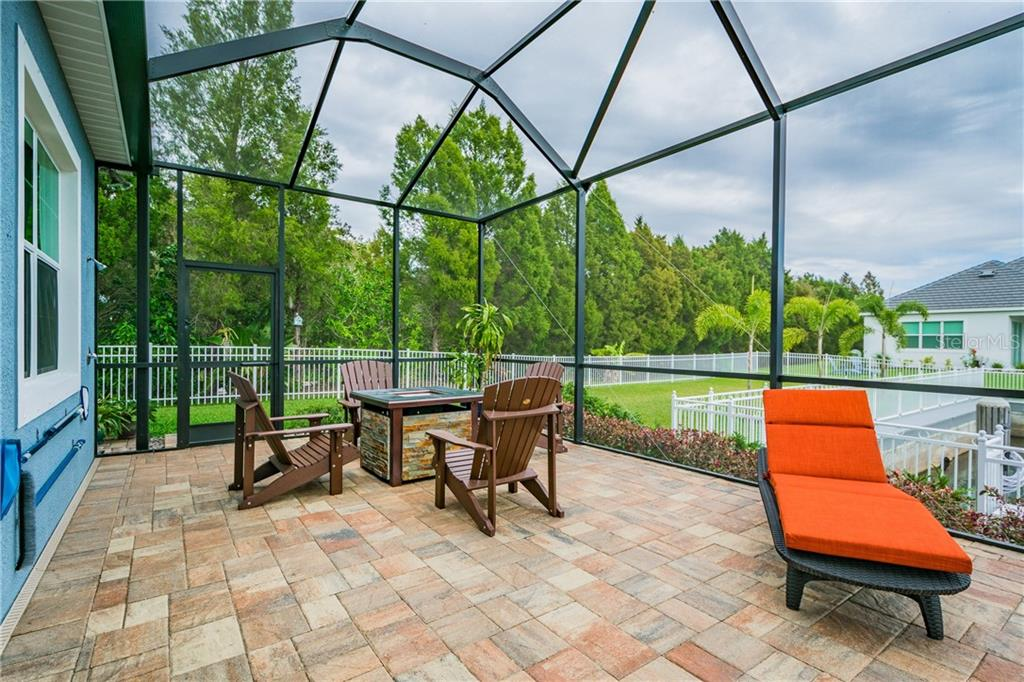 Sit under the stars by the firepit and enjoy the outdoors - Single Family Home for sale at 595 Fore Dr, Bradenton, FL 34208 - MLS Number is A4428657