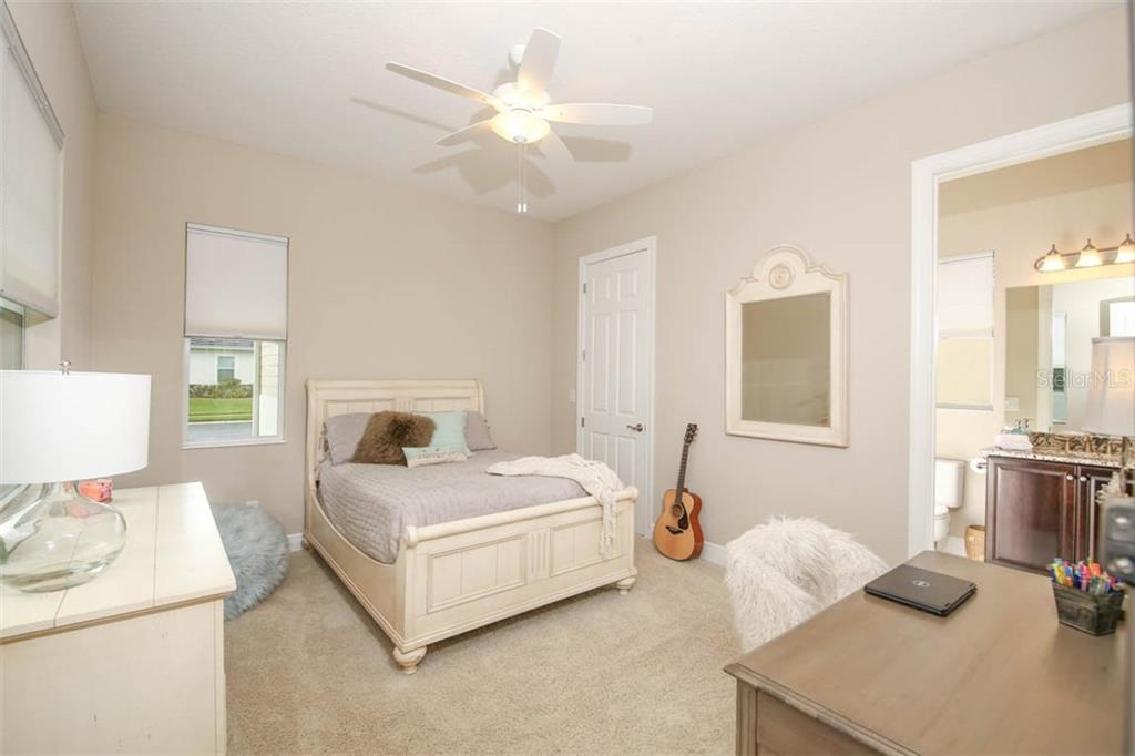 Bedroom 2 has walk in closet and full en-suite bath - Single Family Home for sale at 5504 Tidewater Preserve Blvd, Bradenton, FL 34208 - MLS Number is A4429479