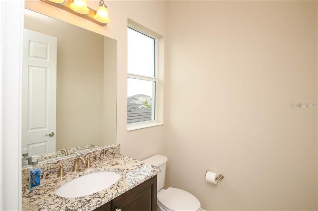 Upstairs Half Bath - Single Family Home for sale at 5504 Tidewater Preserve Blvd, Bradenton, FL 34208 - MLS Number is A4429479