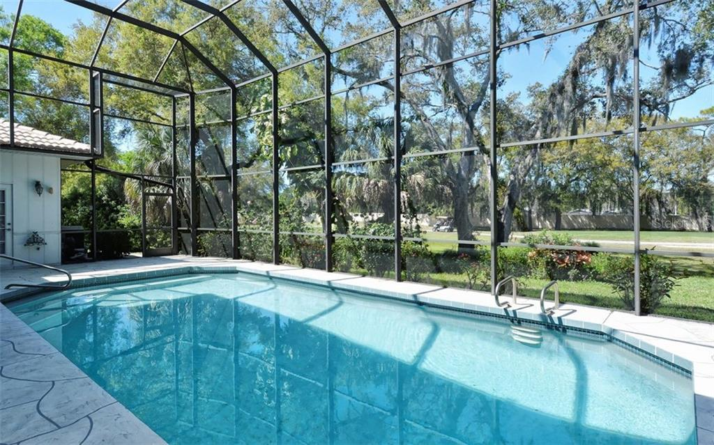 This large heated pool is tropically landscaped and offers full golf course views - Single Family Home for sale at 1636 Liscourt Dr, Venice, FL 34292 - MLS Number is A4429524