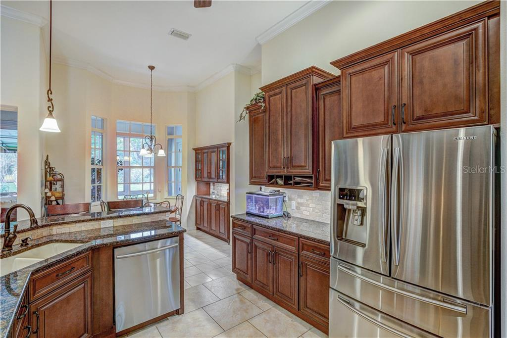 Large refrigerator, built-in mail slots, slide out lowers - Single Family Home for sale at 6321 W Glen Abbey Ln E, Bradenton, FL 34202 - MLS Number is A4429610