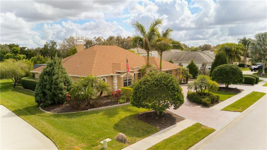 Just gorgeous landscaping on all four sides - Single Family Home for sale at 6321 W Glen Abbey Ln E, Bradenton, FL 34202 - MLS Number is A4429610