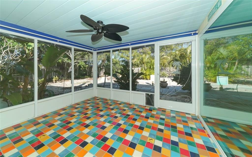 Covered and screened lanai with Italian tile flooring. - Single Family Home for sale at 310 Bayview Pkwy, Nokomis, FL 34275 - MLS Number is A4430065