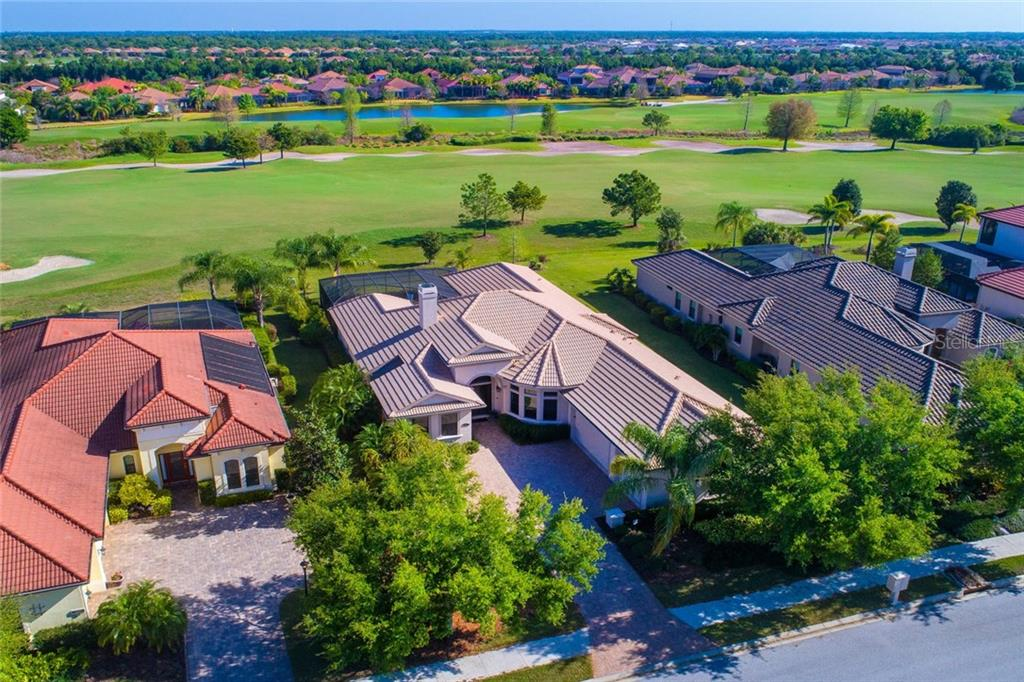 Wonderful views across the 14th fairway of the Rick Robbins designed, Royal Lakes course - Single Family Home for sale at 14611 Leopard Creek Pl, Lakewood Ranch, FL 34202 - MLS Number is A4430144