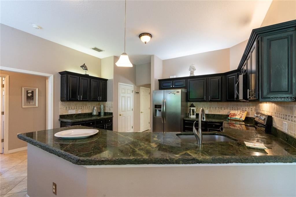 Stainless steel appliances including a wine cooler - Single Family Home for sale at 29215 Saddlebag Trl, Myakka City, FL 34251 - MLS Number is A4431037