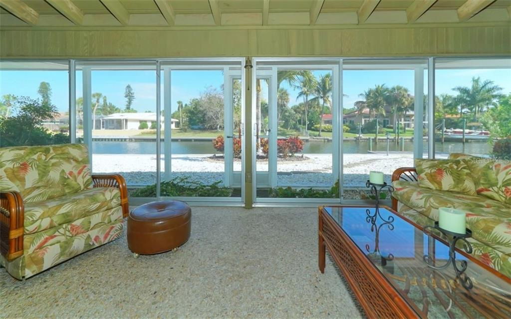COMFORTABLE FLORIDA ROOM OVERLOOKING THE CANAL - Single Family Home for sale at 935 Contento St, Sarasota, FL 34242 - MLS Number is A4431223