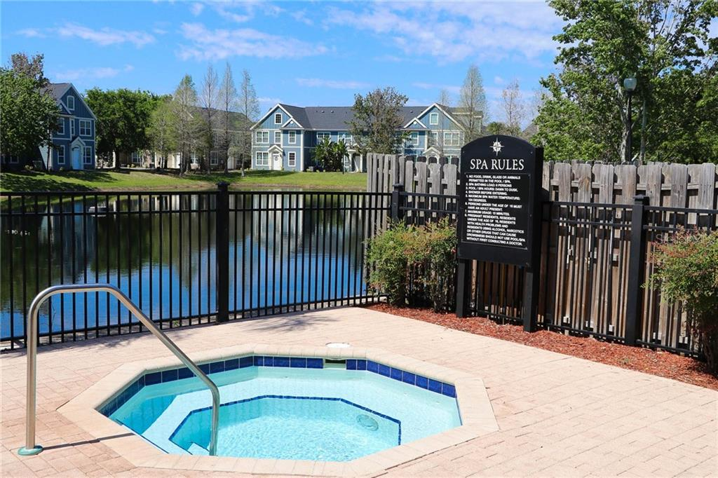 Community Spa Overlooking Lake - Condo for sale at 5511 Rosehill Rd #201, Sarasota, FL 34233 - MLS Number is A4431621