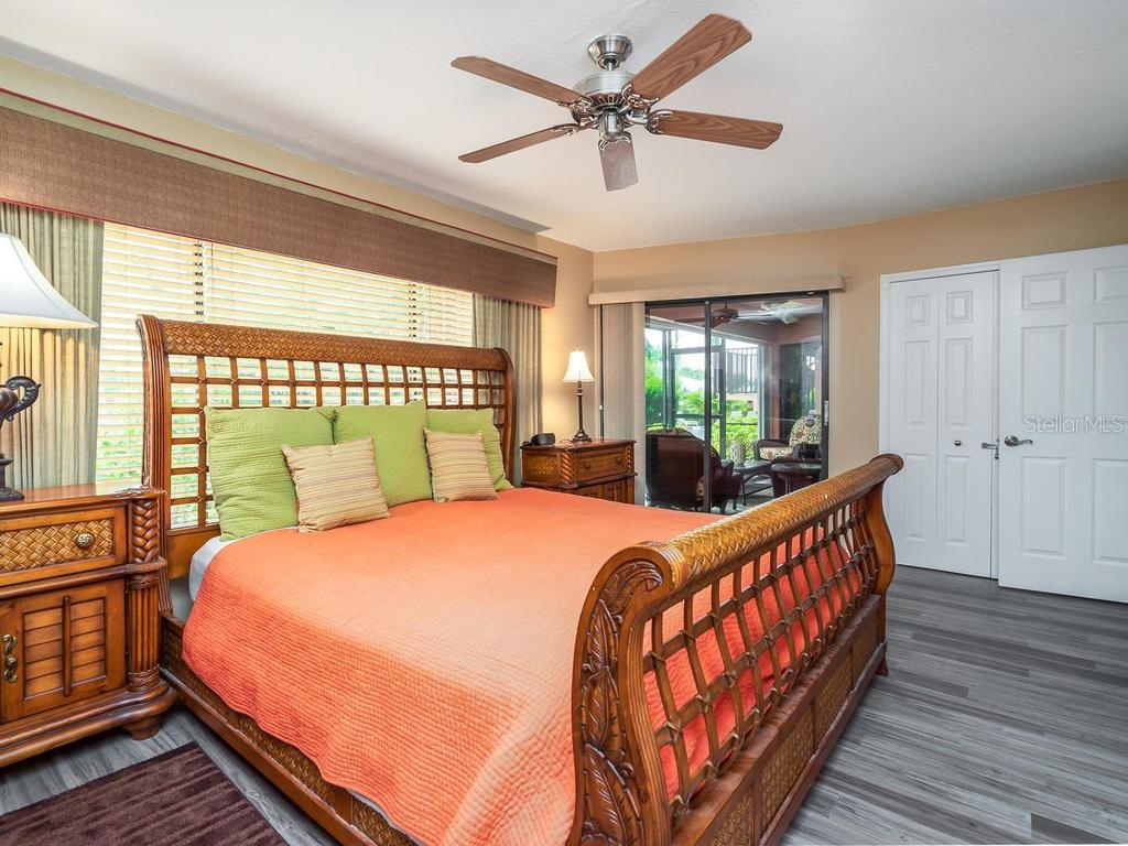 Generous master bedroom suite with king-size bed - Condo for sale at 131 Garfield Dr #1b, Sarasota, FL 34236 - MLS Number is A4432013