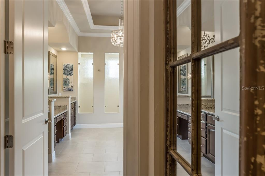 Step into the en-suite master bathroom. - Single Family Home for sale at 19432 Newlane Pl, Bradenton, FL 34202 - MLS Number is A4432094