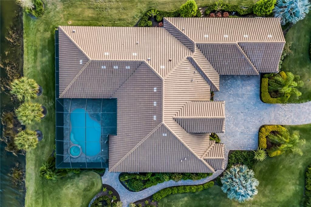 Full overhead aerial of this sprawling residence and lot. - Single Family Home for sale at 19432 Newlane Pl, Bradenton, FL 34202 - MLS Number is A4432094