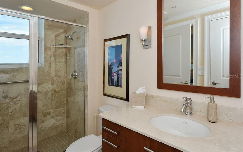 Guest bath with walk-in shower - Condo for sale at 1350 Main St #1500, Sarasota, FL 34236 - MLS Number is A4433444