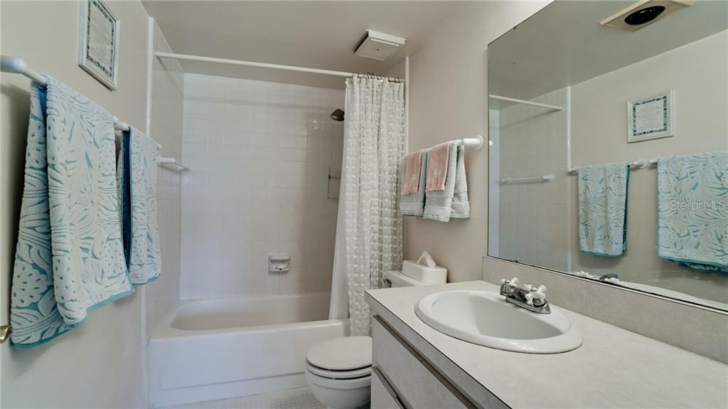 Master bathroom off of master bedroom, shower/tub. - Condo for sale at 7145 Gulf Of Mexico Dr #24, Longboat Key, FL 34228 - MLS Number is A4433880